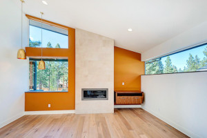 midcentury-modern-living-brass-fireplace-oak-hardwood-vaulted
